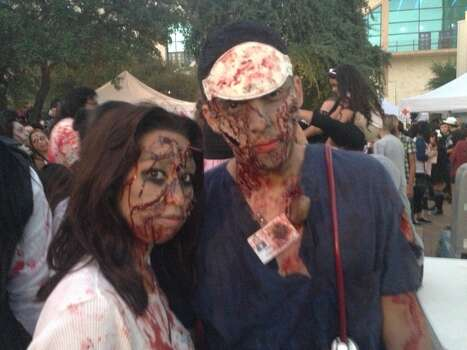 Samantha Lopez and Benny Prieto get into some gruesome detail with their face makeup. Photo: Benjamin Olivo, MySA.com