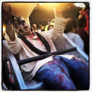 A zombied Mike Taylor takes the roller coaster of death.