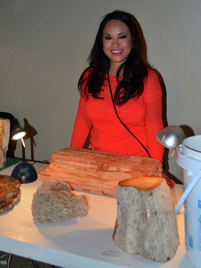 San Jacinto College environmental geology student Gracie Hernandez assists in explaining petrified wood to visitors of the Family Earth Science Festival at the Houston Museum of Natural Science. Photo: Jeannie Peng-Armao, San Jacinto College