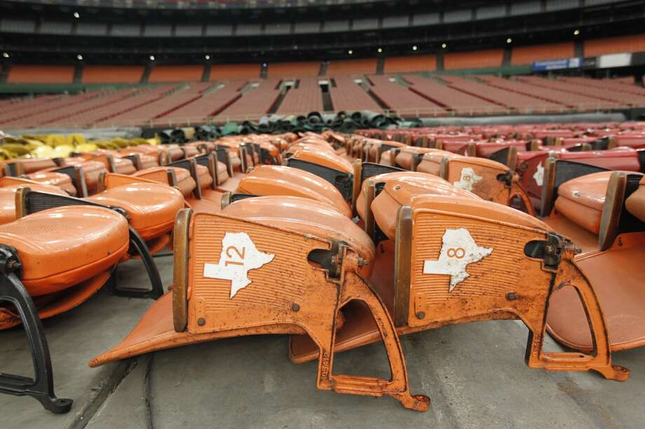 """Astrodome workers sort through items and prepare for a """"yard sale"""" that will open to the public Saturday morning. Seats, turf and other Dome items will be up for sale. (Johnny Hanson/Houston Chronicle) Photo: Johnny Hanson, Houston Chronicle"""