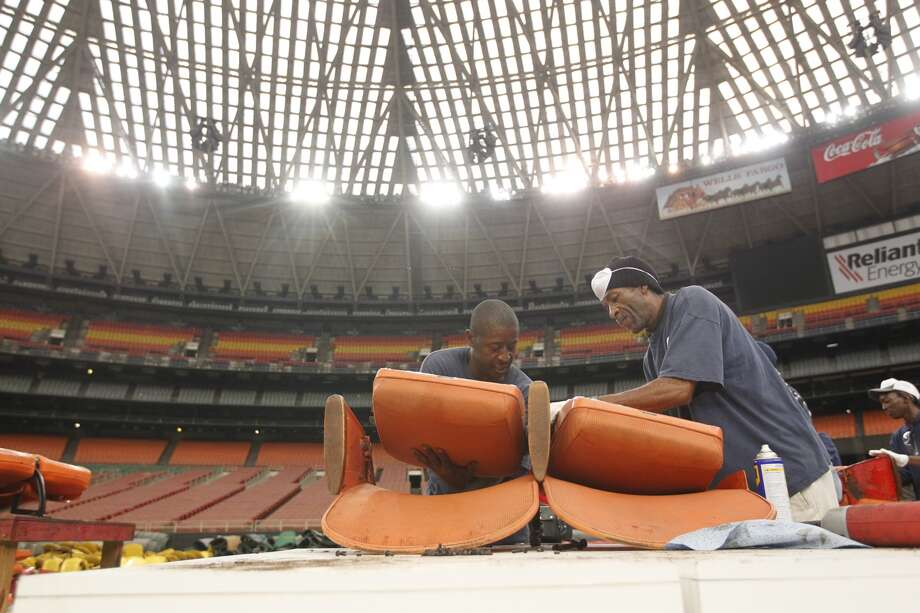 "Astrodome workers sort through items and prepare for a ""yard sale"" that will open to the public Saturday morning. Seats, turf and other Dome items will be up for sale. (Johnny Hanson/Houston Chronicle) Photo: Johnny Hanson, Houston Chronicle"