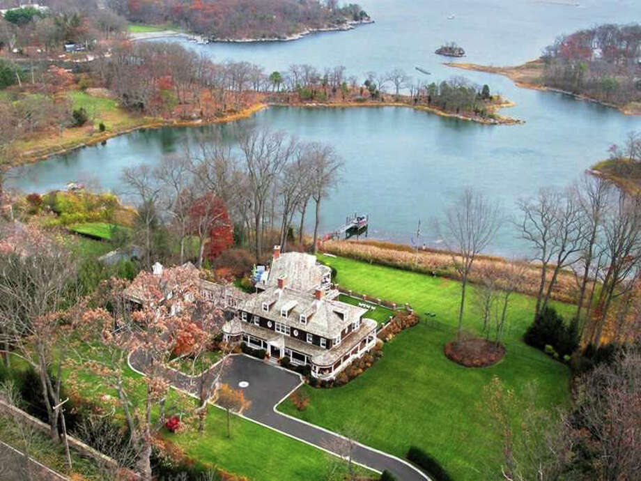 The waterfront estate at 107 Long Neck Point Road in Darien sold for $14.9 million. It has 12,000 square feet of space in a cove-like setting. Photo: Contributed Photo, Contributed / Darien News Contributed