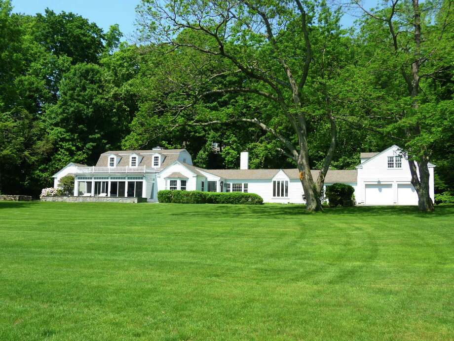 The sprawling house at 45 Swifts Lane in Darien, on the market for $2,995,000, offers plenty of privacy, as well as views of Gorham's Pond. Photo: Contributed Photo, Contributed / Darien News