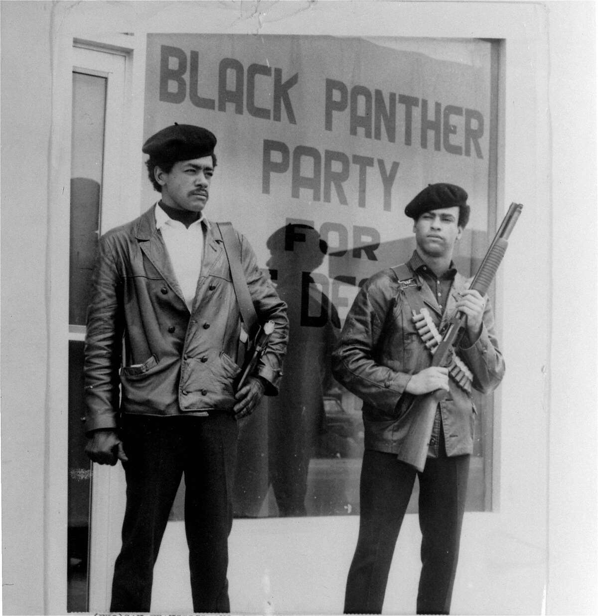 This is an undated photo of Black Panther national chairman Bobby Seale, wearing a Colt .45, left, and Huey Newton, defense minister with a bandoleer and shotgun in Oakland.