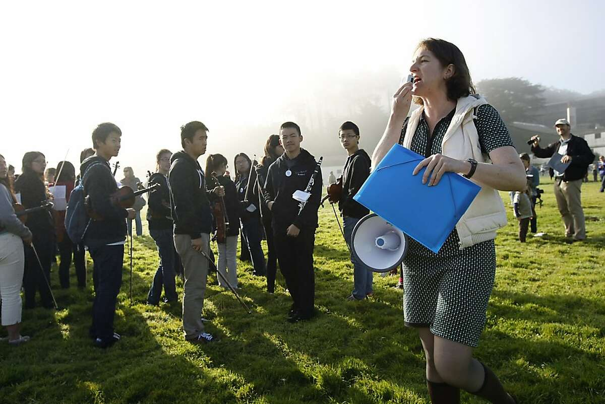 Composer Lisa Bielawa uses a megaphone to organize performers before the start of the Airfield Broadcast performance at Crissy Field in San Francisco, CA Saturday, October 26, 2013. Airfield Broadcast is an hour long