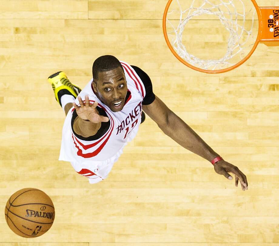 From playmaking to offense to rebounding and defense, Dwight Howard improves the Rockets. And his leadership should make Kevin McHale's job easier. Photo: Smiley N. Pool, Houston Chronicle