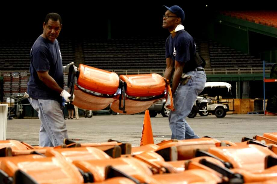 "Astrodome workers sort through items and prepare for a ""yard sale"" that will open to the public Saturday morning. Seats, turf and other Dome items will be up for sale. (Johnny Hanson/Houston Chronicle)"