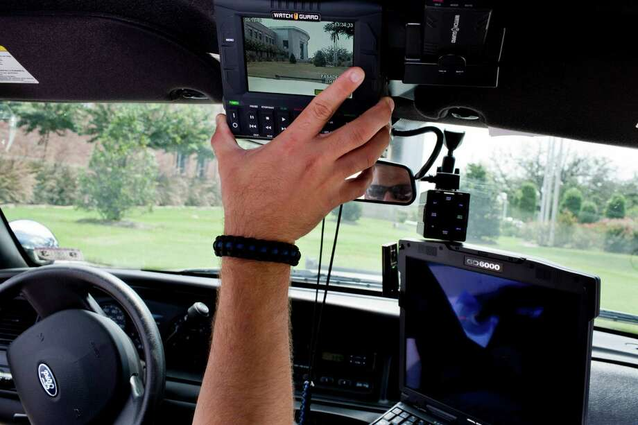 A Pasadena, TX police officer demonstrates his in-car dash camera and monitor, August 19, 2013 in Pasadena, TX. Photo: Eric Kayne, For The Chronicle / ©2013 Eric Kayne