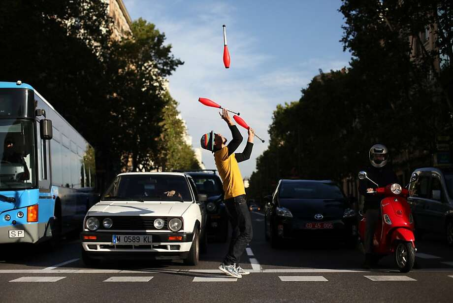 The circus is always in town:One of the main causes of traffic congestion in Madrid is intersection jugglers. Photo: Francisco Seco, Associated Press