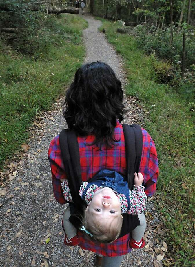Some of the hiking trails near Nashville, Tenn., are best experienced upside-down. (Marlowe Foster, 9 months, and mom Jenny.) Photo: Mark Humphrey, Associated Press