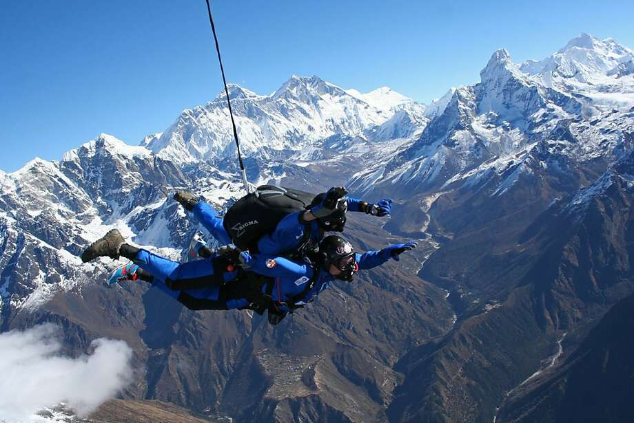 Why? Because it's (down) there:Free falling with tandem skydiving partner Mario Gervasi (top), Marc Kopp of France becomes the first disabled   person to skydive over Mount Everest. Kopp, who suffers from multiple sclerosis, successfully completed his   landing before being taken to hospital as a precaution. Photo: Ryan Jackson, AFP/Getty Images