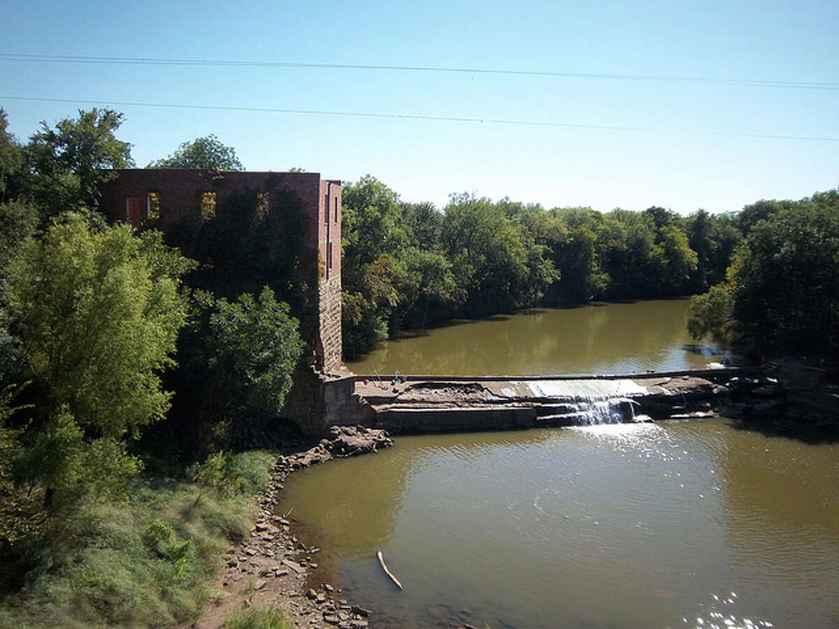 Pictured is the abandoned Donnell Mill on the Brazos River in Eliasville. It was damaged by a fire in 1927 and has not been used since. The town, which is west of Dallas, still consists of a small rural population. It was once the townsite of J.L Dobbs, a settler in the 1870s, and in 1876, ranches were established in the area. The town was named for Elias DeLong, who opened the town's first general store. The town became a city in 1921 thanks to the oil boom, but declined by the '80s. It is no longer a city. Source: Texas State Historical Association