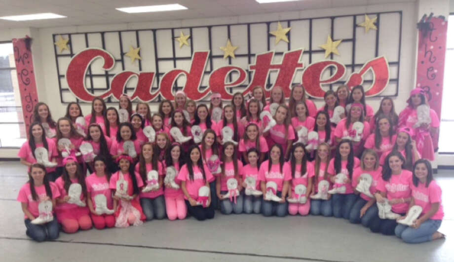 """The Cypress Woods Crimson Cadettes drill team raised more than $3,000 to fight breast cancer through a """"??Pass the Boot""""? fundraiser. Photo: Cypress Woods High School"""