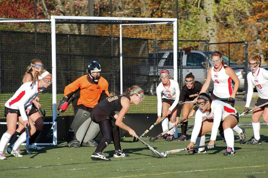 Ridgefield's Katie Grundel (No. 13) attempts to get a shot on goal, but New Canaan defender Tess Decker has other ideas during New Canaanís 2-1 win over Ridgefield in the FCIAC quarterfinals on Saturday, Oct. 26, 2013. By Dave Crandall. Photo: Contributed Photo / New Canaan News