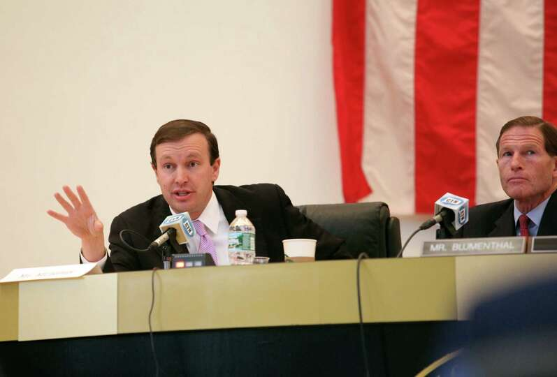 Senator Christopher Murphy, left, and Sen. Richard Blumenthal question a panel during a hearing on t