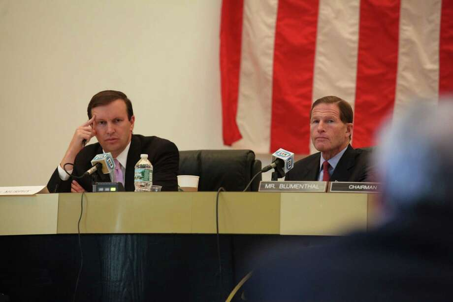 Senator Christopher Murphy, left, and Sen. Richard Blumenthal question a panel during a hearing on the September Metro North power outage at Bridgeport City Hall on Monday, Oct. 28, 2013. Photo: BK Angeletti, B.K. Angeletti / Connecticut Post freelance B.K. Angeletti