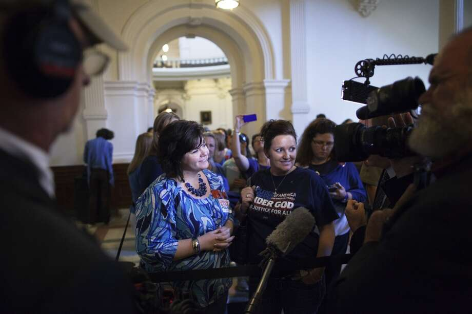 Dallas natives Michelle Smith and Morgan McComb are interviewed for being the first of hundreds in line to enter the Senate Gallery in the State Capitol in Austin, Texas on Friday, July 12, 2013. The Texas Senate's leader, Lt. Gov. David Dewhurst, has scheduled a vote for Friday on the same restrictions on when, where and how women may obtain abortions in Texas that failed to become law after a Democratic filibuster and raucous protesters were able to run out the clock on an earlier special session. (AP Photo/Tamir Kalifa) Photo: Tamir Kalifa, Associated Press