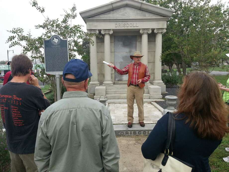 Wendall Fuqua, in front of the tomb of Clara Driscoll, takes questions from a group touring historic, East Side cemeteries through the Office of Historic Preservation. Photo: Jeremy Gerlach / Southside Reporter