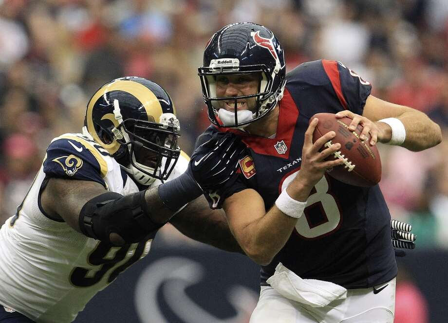 Week 6 vs. Rams  Matt Schaub tries to avoid being sacked by Rams defensive tackle Michael Brockers during the second quarter. Photo: Karen Warren, Houston Chronicle