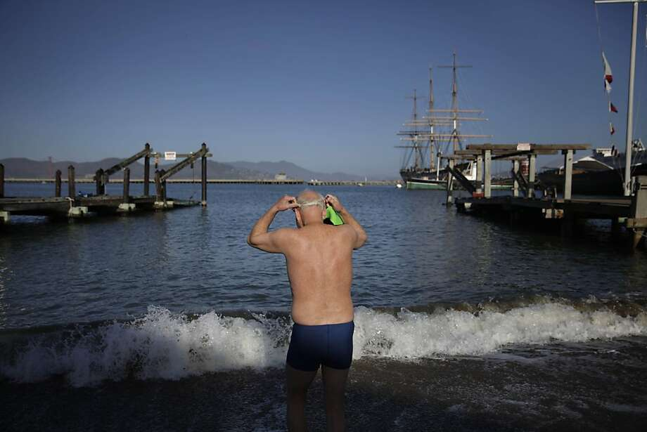 Dolphin Club  member Noel Turner of San Francisco  prepares for a swim as he enters the water at Aquatic Park on Monday, October 28, 2013 in San Francisco, Calif. Photo: Lea Suzuki, The Chronicle
