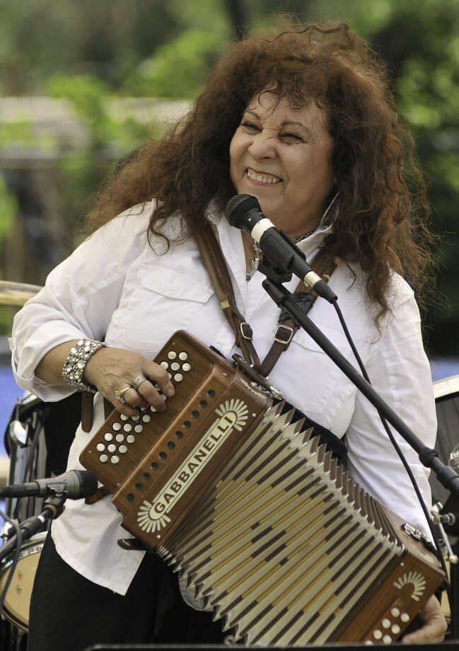 Eva Ybarra performs during last year's Paseo por el Westside Festival. She will play again at the opening night fundraiser for the Muertitos Fest on Thursday. Photo: Robin Jerstad / For The Express-News