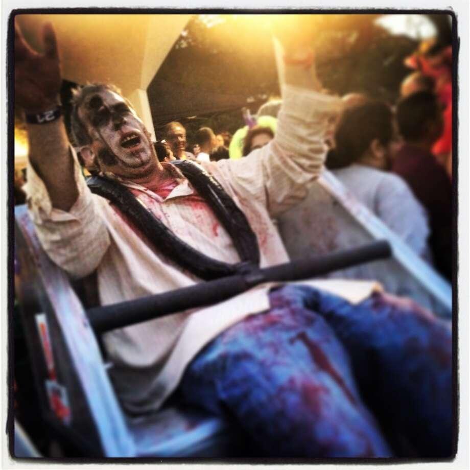 Mike Taylor rides the zombie coaster. Photo: Benjamin Olivo, MySA.com