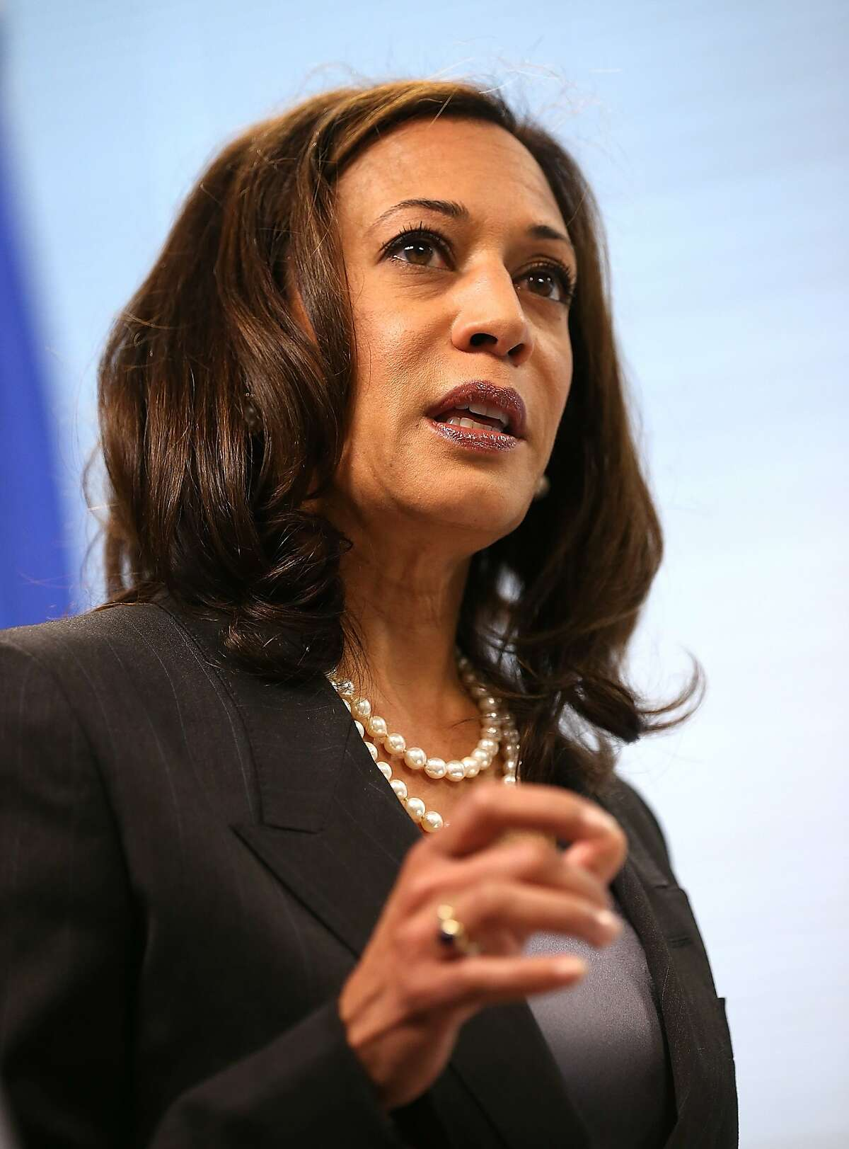 SAN FRANCISCO, CA - OCTOBER 10: California Attorney General Kamala Harris speaks during a news conference on October 10, 2013 in San Francisco, California. Harris announced the filing of a lawsuit against the for-profit Corinthian Colleges and its subsidiaries for alleged false advertising, securities fraud, intentional misrepresentations to students and the unlawful use of military insignias in advertisements. Santa Ana, California-based Corinthian Colleges operates 111 total campuses in North America with 24 Heald, Everest and WyoTech colleges in California that have an estimated 27,000 students. (Photo by Justin Sullivan/Getty Images)