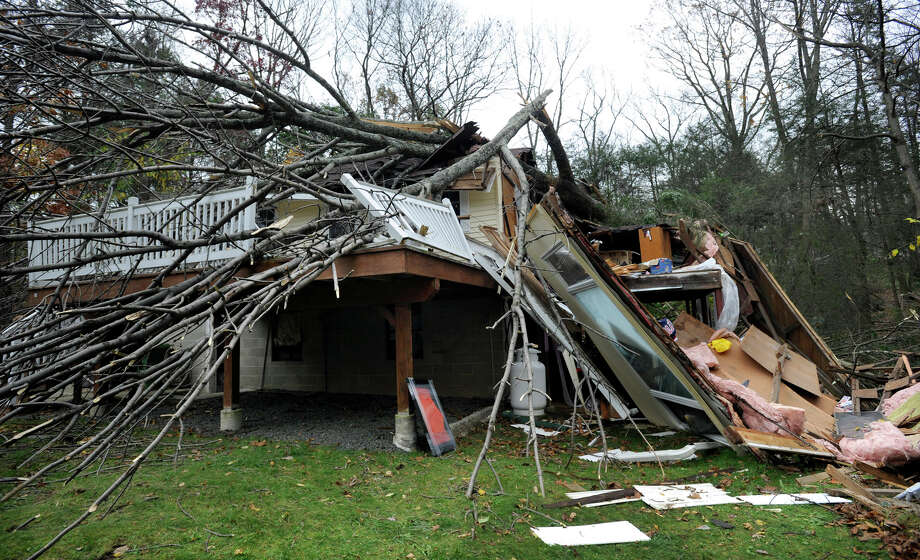 This house in the Lake Waubeeka community in Danbury, Conn.,  was heavily damaged by falling trees during Hurricane Sandy. Photo: Carol Kaliff / The News-Times