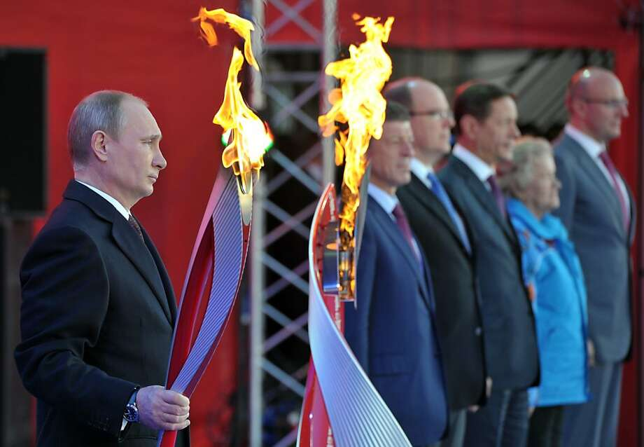 """Russian President Vladimir Putin promises that athletes and visitors to the 2014 Winter Olympics will feel comfortable """"regardless of their ethnicity, race or sexual orientation."""" Photo: Alexei Nikolsky, AFP/Getty Images"""