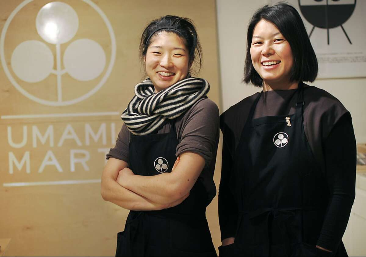 Co-founders Yoko Kumano, 32, left, and Kayoko Akabori, 33, pictured October 24, 2013 at their new pop up, Umami Mart, located inside Perish Trust on Divisarero in San Francisco, Calif. Kumano and Akabori, who have known each other since high school, opened Umami Mart in Oakland one year ago. The entire venture, which features imported Japanese popular barware, glassware, tableware and prints, started with a food blog.