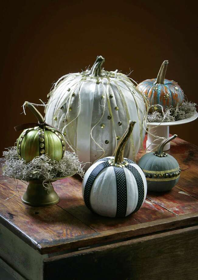 Real pumpkins can be turned into boutiquelike decorations with spray paint, acrylics and a few other accessories. Photo: Jim Barcus, MBR / Kansas City Star