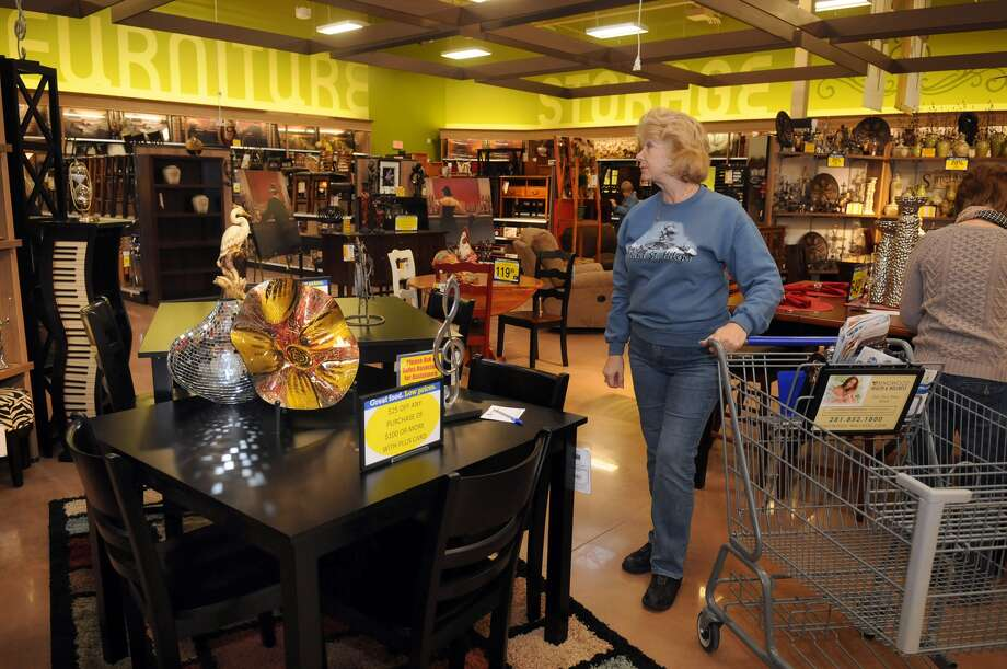 Liv Sanchez, of Oakhurst, checks out the furniture dept. during the grand opening of the Kroger Marketplace in Kingwood. Photo: Jerry Baker, For The Chronicle