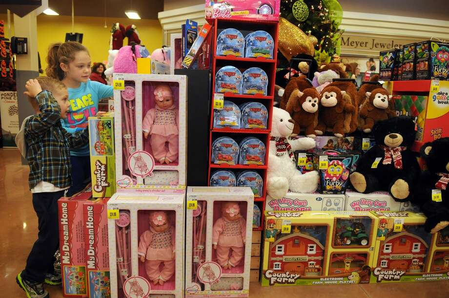 Brooke O'Brien, 7, left, a 2nd grader at Kings Manor Elem., and her brother, Blake, 3, check out the Christmas toy dept. during the grand opening of the Kroger Marketplace in Kingwood. Photo: Jerry Baker, For The Chronicle