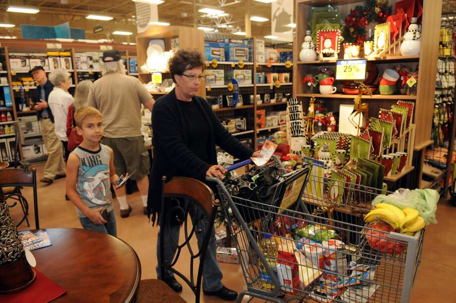 Barbara Hooper, of Kingwood (77339), and her grandson, Andrew Stine, 7, a 2nd grader at Elm Grove Elem., check out the kitchen furnishings during the grand opening of the Kroger Marketplace in Kingwood. Photo: Jerry Baker, For The Chronicle