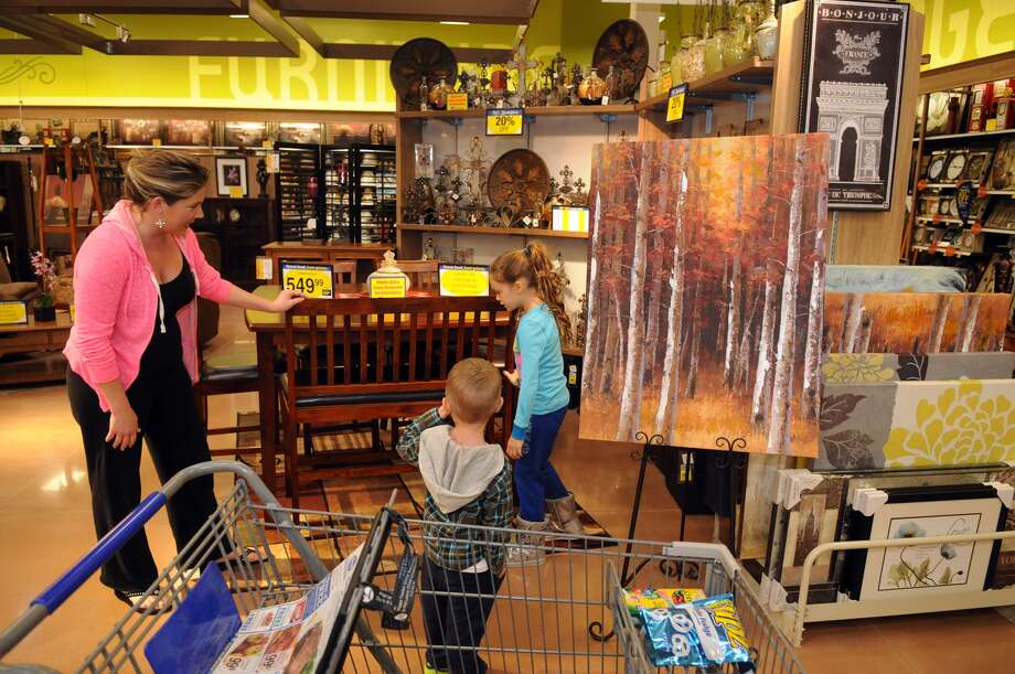 Angie O'Brien, from left, of Kingwood, and her children, Brooke, 7, a 2nd grader at Kings Manor Elementary, and Blake, 3, check out the furniture dept. during the grand opening of the Kroger Marketplace in Kingwood. Photo: Jerry Baker, For The Chronicle