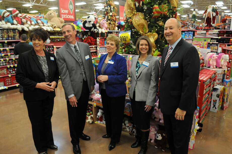 Executive leadership, including Brenda Lightfoot, from left, Ron Parucki, Dana Zurcher, Martha Freitas, and Bill Breetz, President of Kroger Southwest, team up to welcome customers during the grand opening of the Kroger Marketplace in Kingwood. Photo: Jerry Baker, For The Chronicle