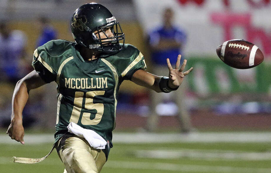 Cowboy quarterback Ralph Vidal pitches the option to his running back as McCollum plays Memorial at Harlandale Memorial Stadium earlier this month. Photo: Tom Reel / San Antonio Express-News