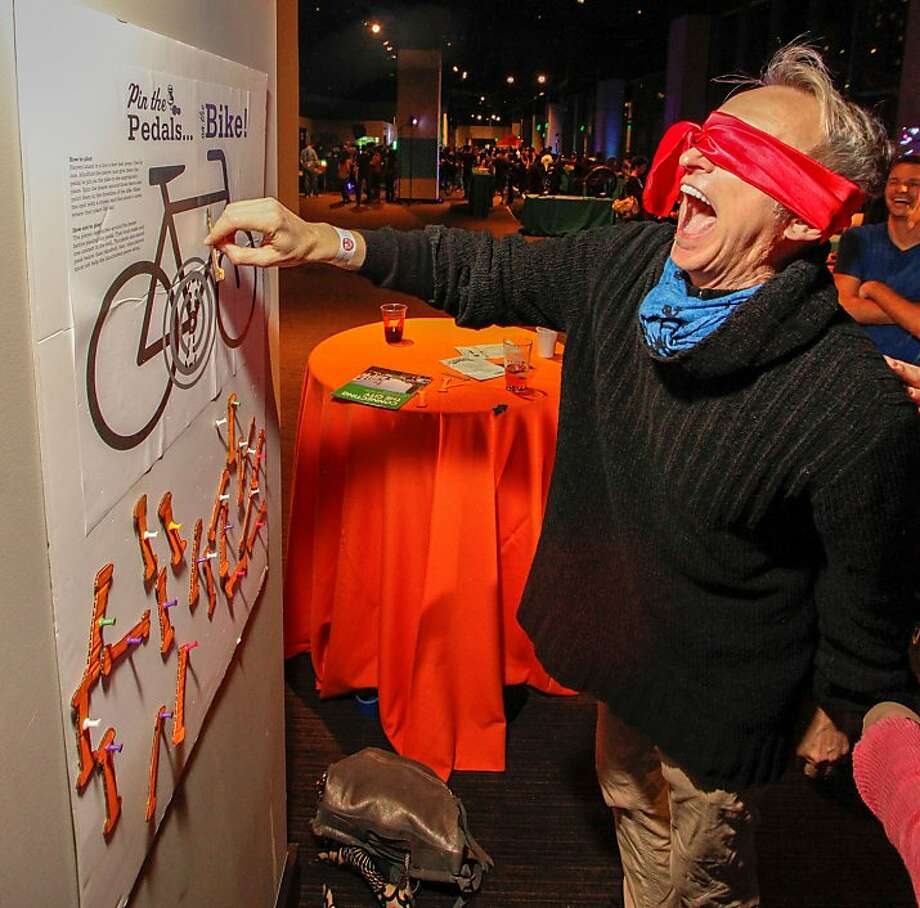 Pin the pedals on the bike, a little Winterfest wackiness, was one form of entertainment at last year's event. The annual Bicycle Coalition celebration is social, informational and entertaining. Photo: Volker Neumann