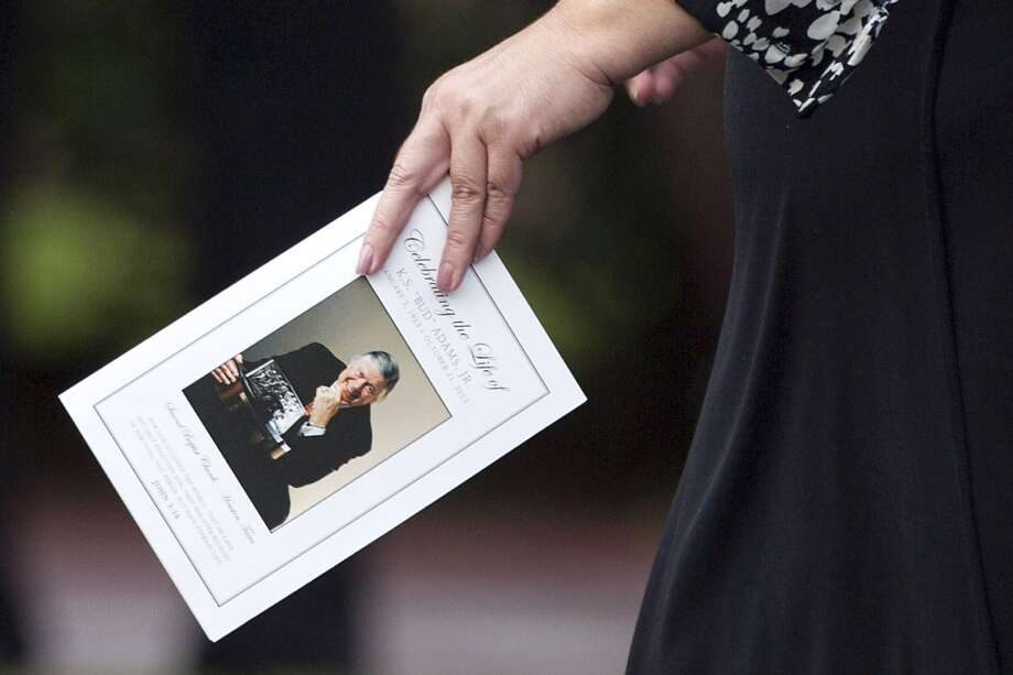 "A mourner carries a program for the memorial service for Titans owner K.S. ""Bud"" Adams at Second Baptist Church on Monday. Photo: Brett Coomer, Houston Chronicle"