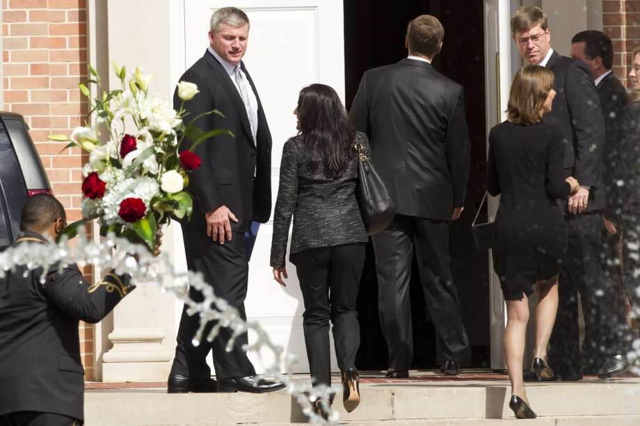 "Titans head coach Mike Munchak, left, arrives to the memorial service for Titans owner K.S. ""Bud Adams at Second Baptist Church on Monday. Photo: Brett Coomer, Houston Chronicle"