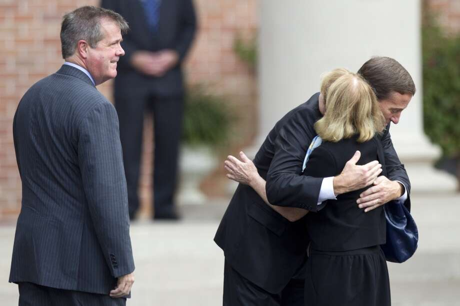Don MacLachlan, executive vice president of administration and facilities for the Tennessee Titans, embraces, Anne Dean, wife of Nashville Mayor Karl Dean, far left, before the memorial service. Photo: Brett Coomer, Houston Chronicle