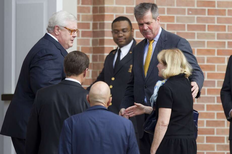 "Tommie Smith, son-in-law of Tennessee Titans owner K.S. ""Bud"" Adams, left, greets Nashville Mayor Karl Dean and his wife, Anne, before Adams' memorial service. Photo: Brett Coomer, Houston Chronicle"