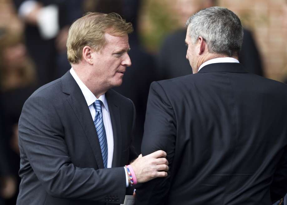 NFL commissioner Roger Goodell, left, greets Tennessee Titans head coach Mike Muchak following the memorial service. Photo: Brett Coomer, Houston Chronicle