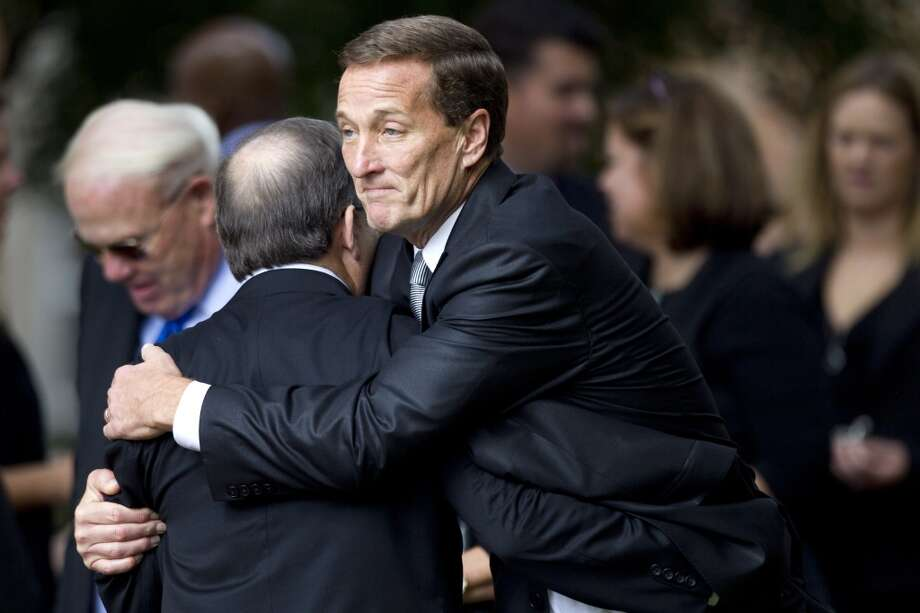 Don MacLachlan, executive vice president of administration and facilities for the Tennessee Titans, embraces a mourner following the memorial service. Photo: Brett Coomer, Houston Chronicle