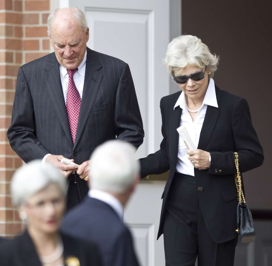 Texans owner Bob McNair, and his wife, Janice, walk out of the church following the memorial service. Photo: Brett Coomer, Houston Chronicle