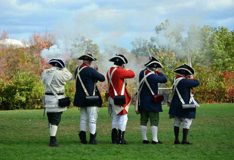 Members of the 5th Connecticut Regiment took part in Colonial Day at Middlesex Middle School on Fri., Oct. 25. The volunteer regiment reenacted their weapons routine, using their rifles and bayonets. Photo: Megan Spicer / Darien News