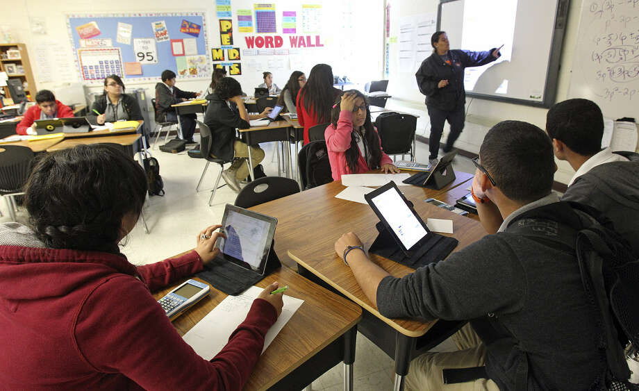 Students in an algebra class at Gus Garcia Middle School use their iPads. Edgewood is making strides in improving the educational environment. Photo: San Antonio Express-News File Photo