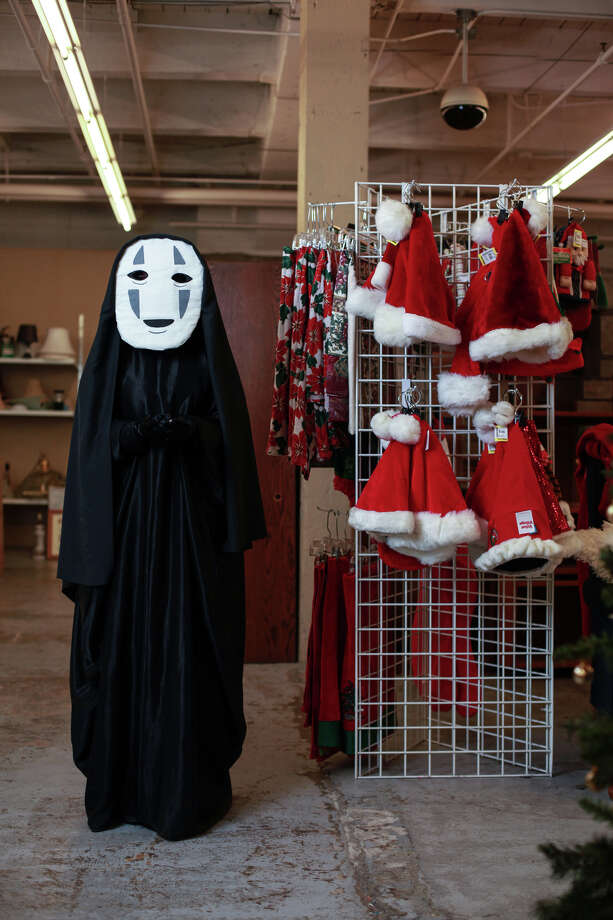 "Dana Hill models a ""No Face from Spirited Away"" costume at Seattle's Capitol Hill Value Village.Black robe - $9.99Black material - $4.99About $15 Photo: SOFIA JARAMILLO, SEATTLEPI.COM / SEATTLEPI.COM"