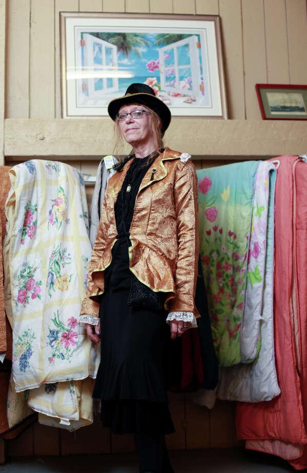 "Christy Soderstrom shows off her ""Old Western Aristocrat"" costume at Seattle's Capitol Hill Value Village.Vintage dress - $14.99Fancy hat - $4.99Gold blazer - $7.99About $28 Photo: SOFIA JARAMILLO, SEATTLEPI.COM / SEATTLEPI.COM"