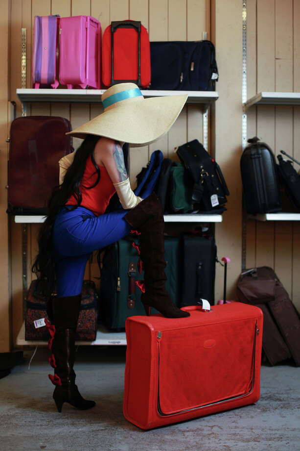 "Katie Chinn models a ""Marceline, the Vampire Queen from Adventure Time"" costume at Seattle's Capitol Hill Value Village.Long Gloves - $4.99Boots - $19.99Hat - $4.99Luggage - $7.99About $38 Photo: SOFIA JARAMILLO, SEATTLEPI.COM / SEATTLEPI.COM"